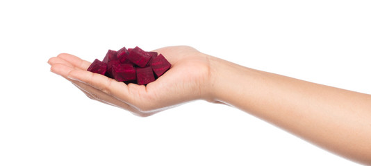 hand holding Beetroot. Cubes isolated on white background.