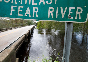 The Northeast Cape Fear River rises higher towards a bridge as breaks its banks after Hurricane Florence in Burgaw, North Carolina