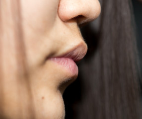 Close up of an attractive young lady, lips, hair