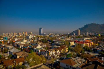 SANTIAGO, CHILE - SEPTEMBER 13, 2018: Outdoor view of Skyline of Santiago de Chile at the foots of The Andes Mountain Range and buildings at Providencia district
