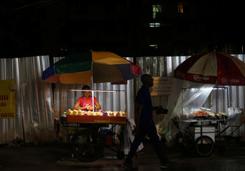 Street vendors sell food in Sukhumvit Soi 11 in Bangkok