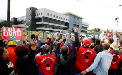 Supporters of Workers Party chants slogans in front of the Federal Police headquarters, where Brazilian former President Luiz Inacio Lula da Silva is imprisoned, in Curitiba