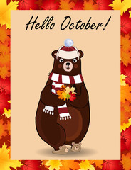 Hello october poster with cute bear in hat and scarf holding fallen leaves