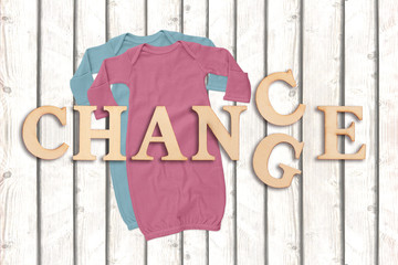 "word ""change"" with baby clothes on white wooden background"