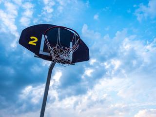 Basketball ring against the blue sky. Street sports. Basketball.