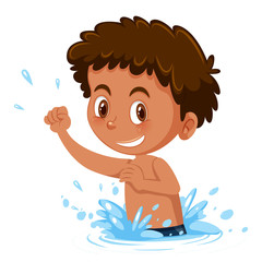 Young boy splashing in water