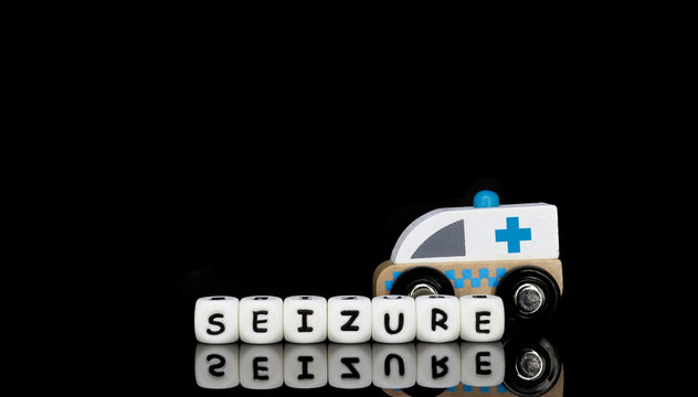 a toy ambulance and a word seizure