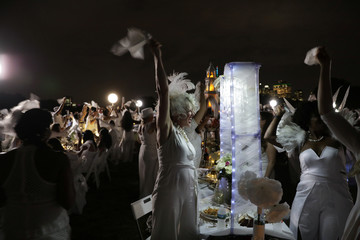 Diner En Blanc, a secret pop-up dinner, is held this year on Governors Island in New York, U.S.