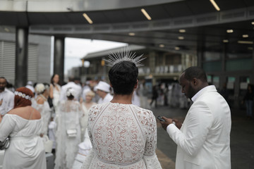 Diner En Blanc, a secret pop up dinner, is held this year on Governors Island in New York, U.S.