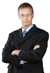Professional looking man with his arms crossed wearing a suit