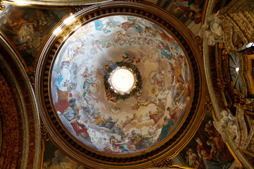 Inside view of the dome of Church of St. Ignatius of Loyola at Campus Martius, Rome, Italy, with paintings and frescos