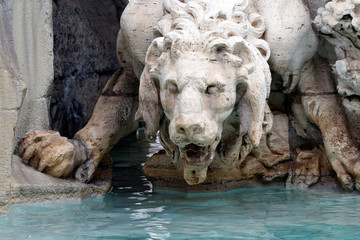 Lion sculpture detail in The Fountain of the Four Rivers (The Fontana dei Quattro Fiumi) in the Piazza Navona in Rome, Italy.  Monument was built by Gian Lorenzo Bernini in 1651.