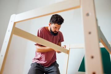 Man Working On Carpentry At Home