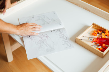 Man Working On Carpentry At Home, closeup