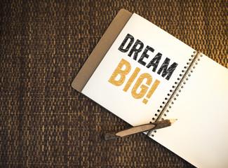 Dream big written on a notebook