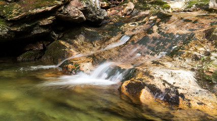 Slow shutter photo of a small waterfall from the Massif du Sud in the Province of Quebec, Canada.