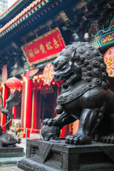 close up Lion Guardian bronze sculpture at the Sik Sik Yuen Wong Tai Sin Temple in Kowloon, Hong Kong.