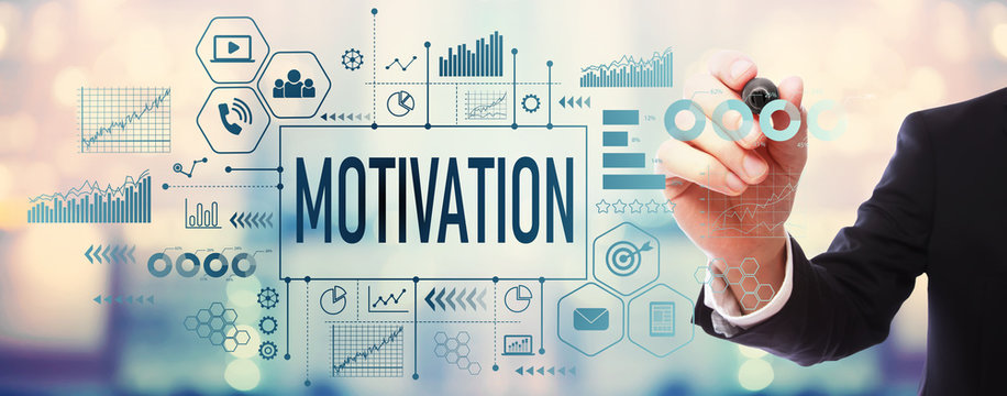 Motivation with businessman on blurred abstract background