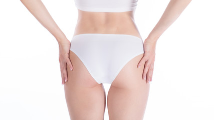 Female cropped fit buttocks in base white panties, isolated on white.