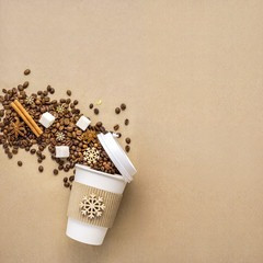 Winter coffee / Creative concept photo of take away coffee cup on brown background.