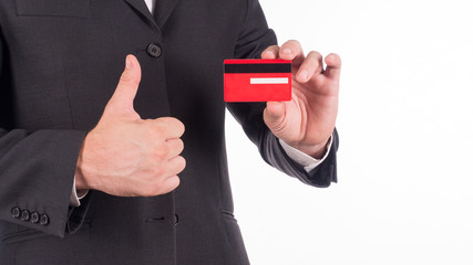Cropped image of business man in suit holding credit card in hand. Isolated on white background.
