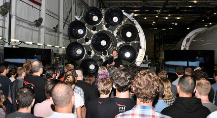 SpaceX CEO Elon Musk talks to his workforce as he announces the world's first private passenger scheduled to fly around the Moon aboard SpaceX's BFR launch vehicle, at the company's headquarters in Hawthorne