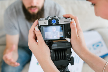 video content creation process. woman holding camera and shooting footage for blog or online courses. professional equipment and helpful tools concept.