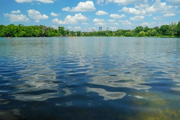 Panoramic view of downtown Minneapolis from a Cedar Lake in summer