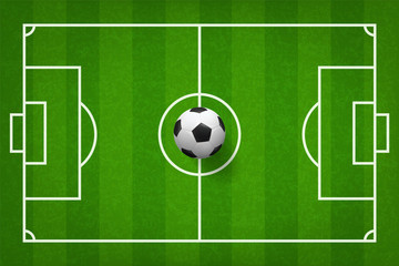 Soccer football ball on green grass of soccer field pattern background. Vector.