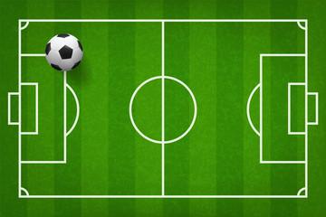 Soccer football ball on green grass of soccer field pattern background. Vector.