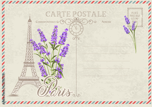 old blank postcard with post stamps and eiffel tower with lavender
