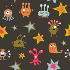 Seamless pattern with cute cartoon monsters on a dark background