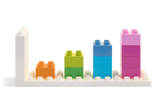 Four bars chart made from colorful building blocks toys