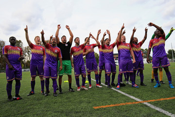 Clapton CFC players celebrate their win against Ealing Town in East Acton, in London