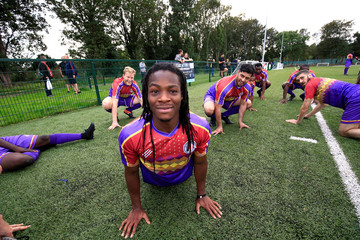 Clapton CFC players prepare for their away game with Ealing Town in East Acton, in London