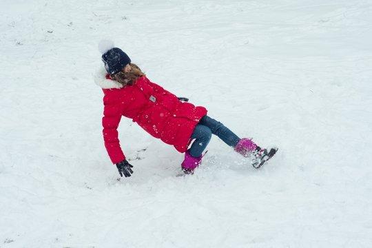 Winter danger, the girl slipped and falls