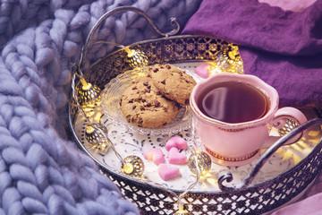 Pink cup of tea,cookies, garland