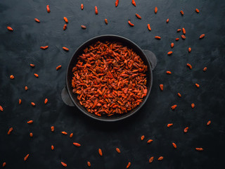 Goji berries on the black table. Top view.