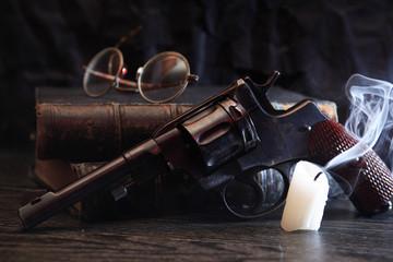 Old Revolver Near Book
