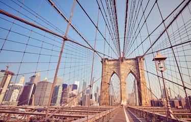 Brooklyn Bridge at sunrise, vintage stylized picture, New York City, USA.