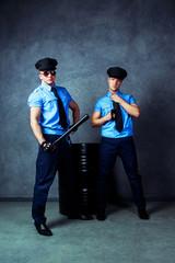 dancers wearing costumes of policemen