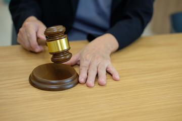 judge holding legal law gavel at courtroom. lawyer attorney justice