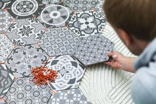 tiler laying floor tiles