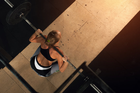 Top view - Strong Female training in the gym