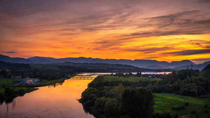 Wall Mural - Sunset over a river in Slovakia