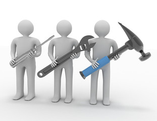 Three people with the tools in the hands.