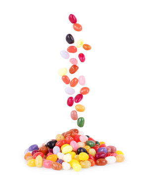 Pile of multiple jelly bean candies on a white background