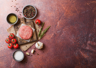 Raw minced home made grill beef burger with spices and herbs. Top view with space for your text
