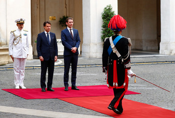 Austrian Chancellor Sebastian Kurz and Italian Prime Minister Giuseppe Conte listen to the national anthems at Chigi palace in Rome
