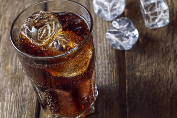 A glass with ice and cola.